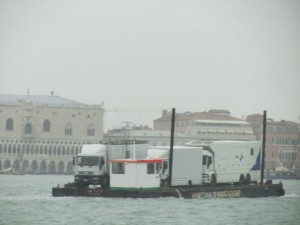 Nothing to do with the Fenice or this story, but it's an interesting shot of television trucks with satellites parked on a barge in the Grand Canal...the closest they can get to St. Marks if there's an event going on.