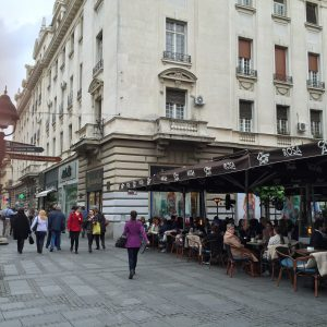 A pedestrian street with outdoor cafes.